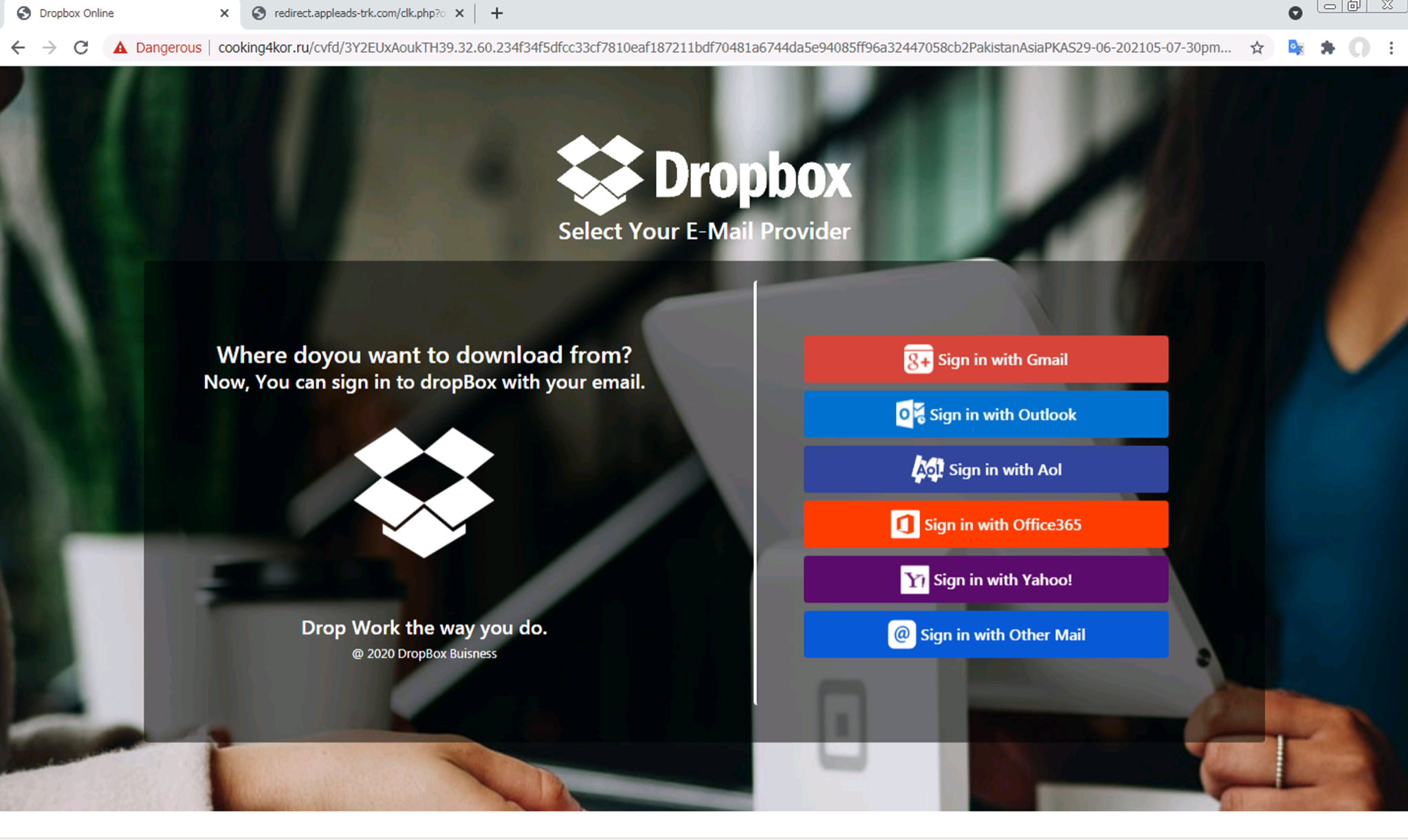 A phishing webpage impersonating a Dropbox login page. No credential-stealing forms are apparent until the user interacts with the page.