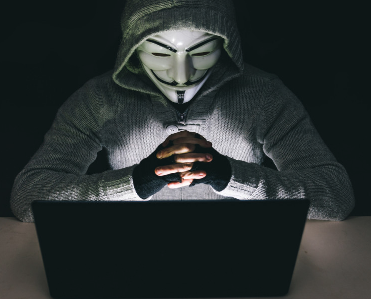 A 2021 Facebook profile picture, showing a background image of the Guy Fawkes/Anonymous mask.